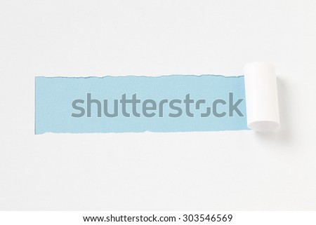torn paper on blue background  - stock photo