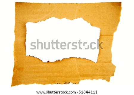 Torn paper on cardboard over plain background