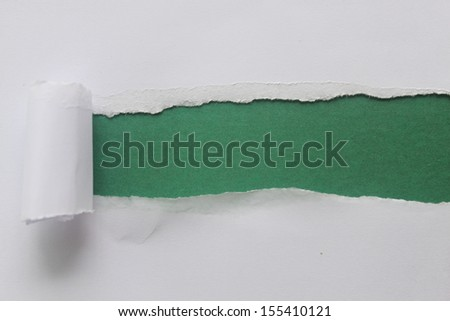 Torn paper over a blank green background for message - stock photo