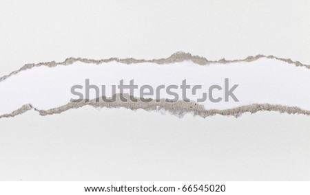 Torn paper strip series - white cardboard ripped apart showing underlying layer - stock photo