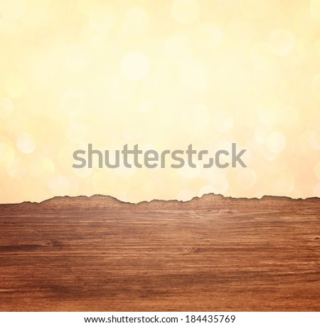 torn paper with glitter lights effect over wooden background - stock photo