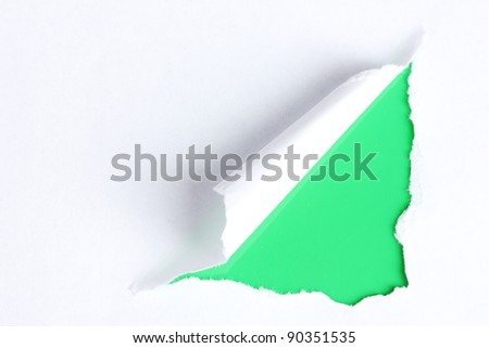 Torn paper  with green background - stock photo