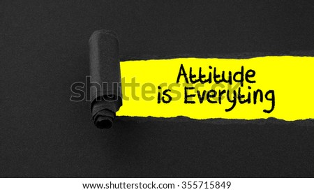 Torn paper with text Attitudeis Everyting - stock photo