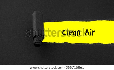 Torn paper with text Clean Air - stock photo
