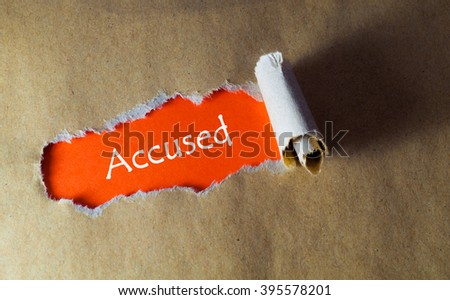 torn paper with word accused - stock photo