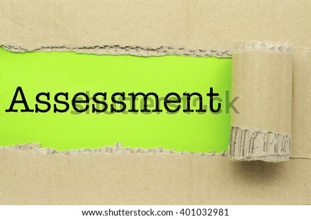 Torn Paper with word  Assessment - stock photo