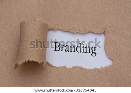 torn paper with word branding - stock photo