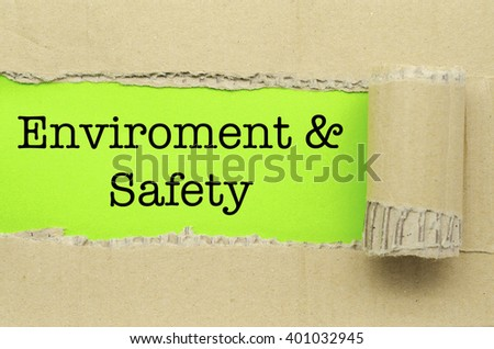Torn Paper with word Environment & Safety - stock photo