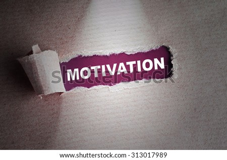 Torn paper with word Motivation