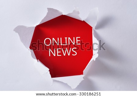 """Torn Paper with Word """"ONLINE NEWS"""" - stock photo"""