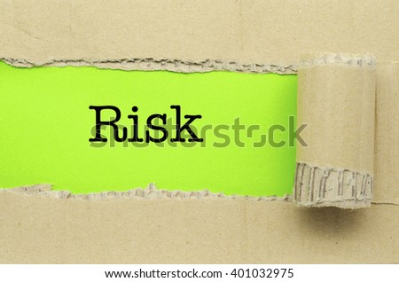 Torn Paper with word Risk - stock photo