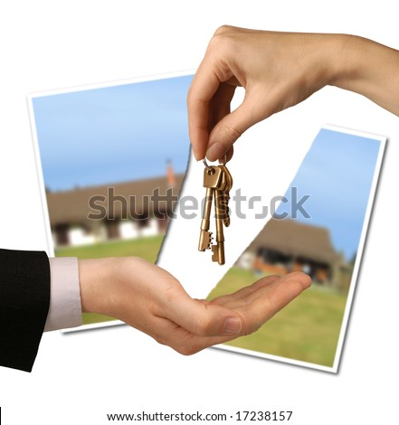 torn photograph of a house behind hands passing keys - stock photo