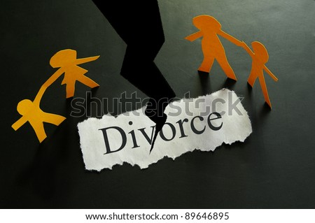 torn piece of paper with divorce text and paper family figures - stock photo