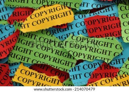 """Torn pieces of colored paper with the word """"Copyright"""". Copyright concept. Closeup. - stock photo"""