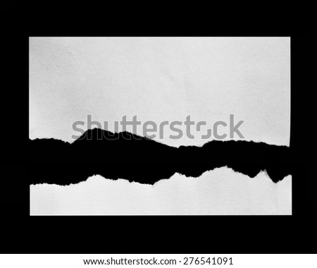 Torn pieces of paper on black background, space for advertising copy - stock photo