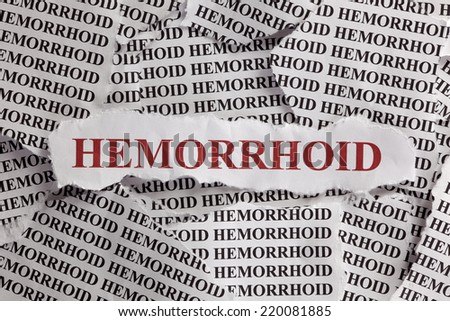 "Torn pieces of paper with words ""Hemorrhoid"""