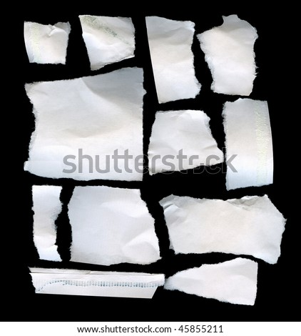 Torn Real Paper Scraps On Black Background - stock photo