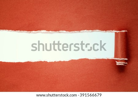 Torn red paper on with white background  with copy-space.
