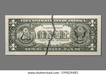Torn US Dollar note, close-up - stock photo