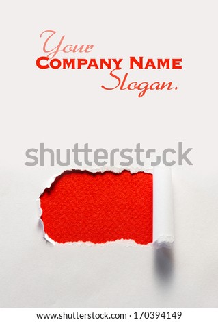 Torn white paper showing a red one - stock photo
