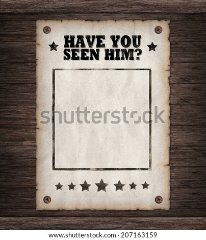 Torn Wild West. Have you seen him poster on old wooden wall  - stock photo