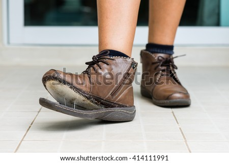 torn women shoe, closeup broken women leather shoe need to repair - stock photo