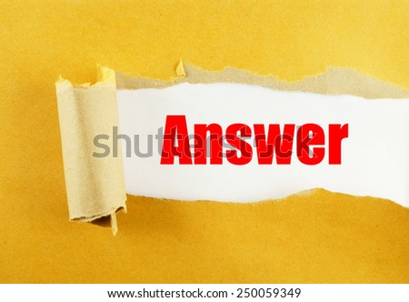 Torn yellow paper with word answer on white background  - stock photo