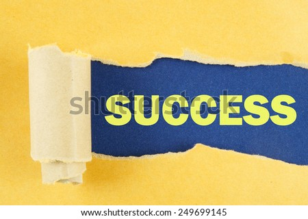 Torn yellow paper with word success on blue background  - stock photo