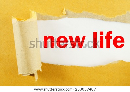 Torn yellow paper with words new life on white background  - stock photo