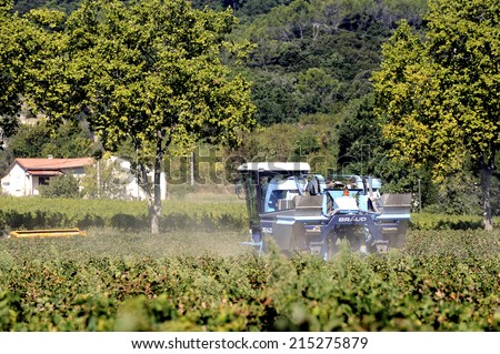 TORNAC, FRANCE - SEPTEMBER 2: The harvest with machines to harvest the grapes in France in the department of Gard, september 2, 2014.