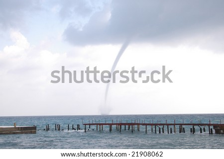 tornado above the sea - stock photo