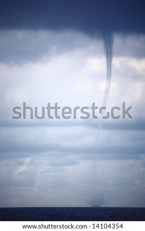 Tornado and storm clouds in the Indian Ocean - stock photo