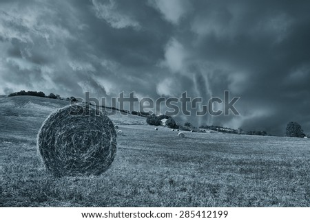 tornado in countryside in summer - stock photo