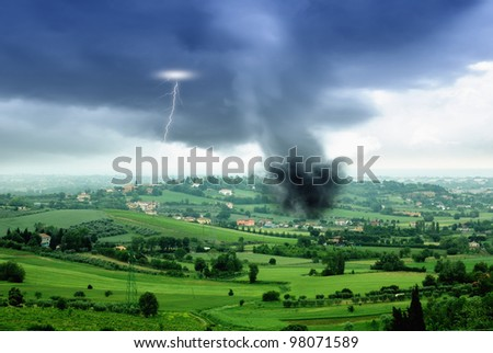tornado in the valley in spring - stock photo