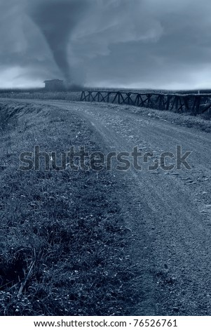 tornado incoming hit building near country road - stock photo