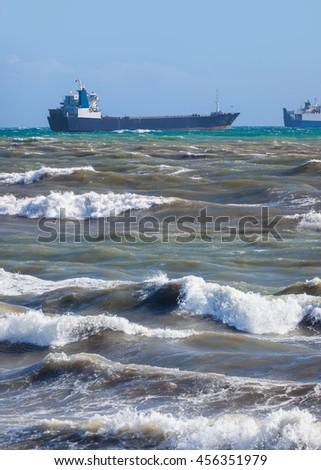 Tornado on the Black Sea and sailing ship. - stock photo