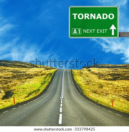 TORNADO road sign against clear blue sky - stock photo