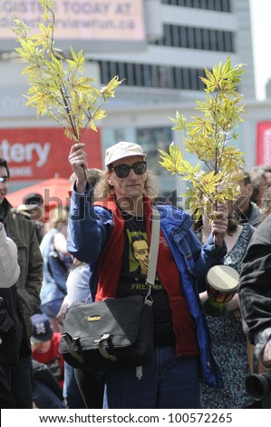 TORONTO - APRIL 20:  An unidentified marijuana supporter  holding marijuana plants during the annual marijuana 420 event at Yonge & Dundas Square  on April 20  2012 in Toronto, Canada. - stock photo