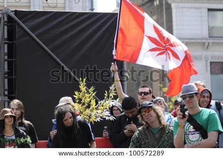 TORONTO - APRIL 20: Marijuana legalization supporters listening to music during the annual marijuana 420 event at Yonge & Dundas Square  on April 20  2012 in Toronto, Canada. - stock photo