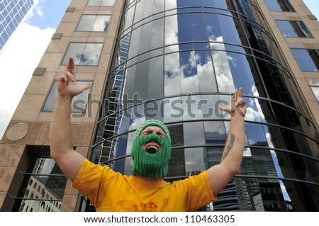 """TORONTO -AUGUST  17:  An angry protester chanting slogans during a protest rally organized to free """"pussy riot""""on August 17 2012 in Toronto, Canada. - stock photo"""