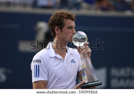 TORONTO: AUGUST 15. Andy Murray greets his fans after he won a tournament with Roger Federer in the Rogers Cup 2010 finals on August 15, 2010 in Toronto, Canada. - stock photo