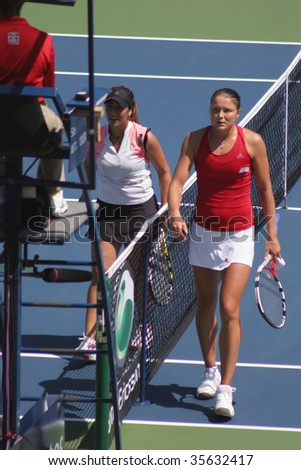 TORONTO - AUGUST 19: Aravane Rezai (L) of France plays against Dinara Safina of Russia at the Rogers Cup on August 19, 2009 in Toronto, Canada.