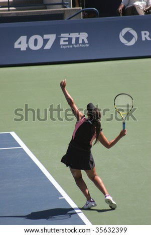 TORONTO - AUGUST 19: Aravane Rezai (picture) of France plays against Dinara Safina of Russia at the Rogers Cup on August 19, 2009 in Toronto, Canada. - stock photo