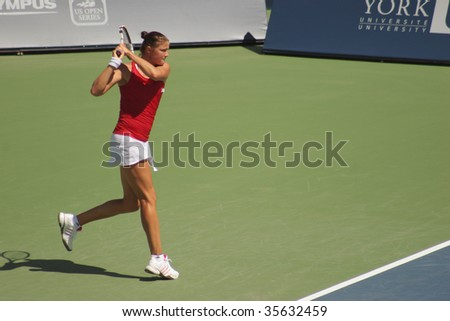 TORONTO - AUGUST 19: Dinara Safina (picture) of Russia plays against Aravane Rezai of France at the Rogers Cup on August 19, 2009 in Toronto, Canada. - stock photo