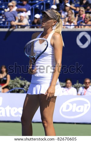 TORONTO: AUGUST 12. Maria Sharapova plays against Galina Voskoboeva in the Rogers Cup 2011 on August 12, 2011 in Toronto, Canada. - stock photo