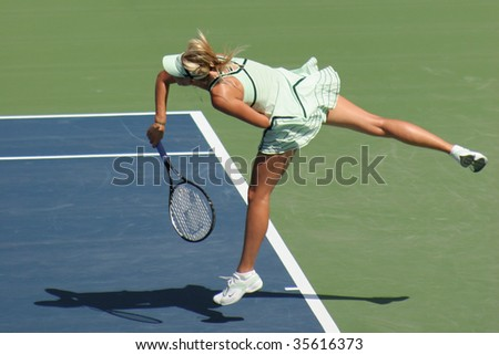 TORONTO - AUGUST 19: Maria Sharapova, Russia, plays at the Rogers Cup vs. Sybille Bammer, Austria, on August 19, 2009 in Toronto - stock photo