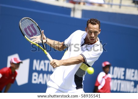 TORONTO- AUGUST 12:Michael Llodra plays against Roger Federer in the Rogers Cup 2010 on August 12, 2010 in Toronto, Canada. - stock photo