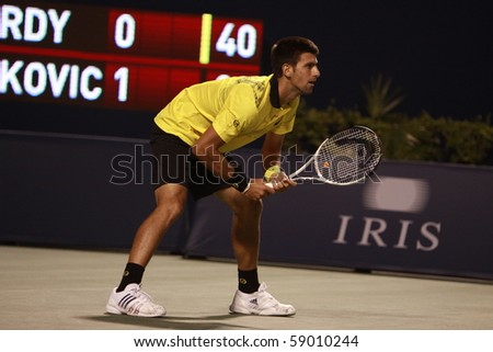 TORONTO- AUGUST 13: Novak Djokovic plays against Jeremy Chardy  in the Rogers Cup 2010 on August 13, 2010 in Toronto, Canada. - stock photo