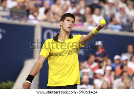 TORONTO: AUGUST 14. Novak Djokovic plays against Roger Federer   in the Rogers Cup 2010 on August 14, 2010 in Toronto, Canada. - stock photo
