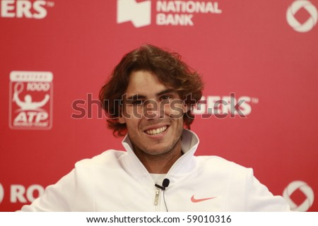 TORONTO- AUGUST 13: Rafael Nadal gives an interview in press conference after he won a tournament with Philipp Kohlschreiber in the Rogers Cup 2010 on August 13, 2010 in Toronto, Canada. - stock photo